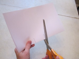 "Step 1: Fold one piece of paper in half the hamburger way. Near the center of the folded edge of the paper, cut two lines each the same length (about 1"" long). The cuts should be about 1 1/2"" apart. You may want students to mark cut lines with rulers when you first get started."