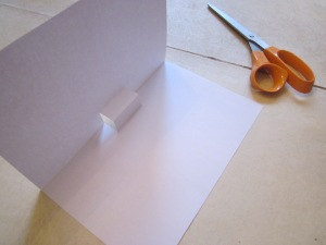 Step 3: Fold the paper down again like a hamburger and crease your stair step. Open the page and stand upright to check that the fold is even.