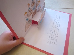 Step 4: Begin creating illustrations on the page. You will have one larger element that is cut out of paper and glued to the front of the stair step. Create a background on the top/back of the page. Write the story text on the bottom/front of the page.