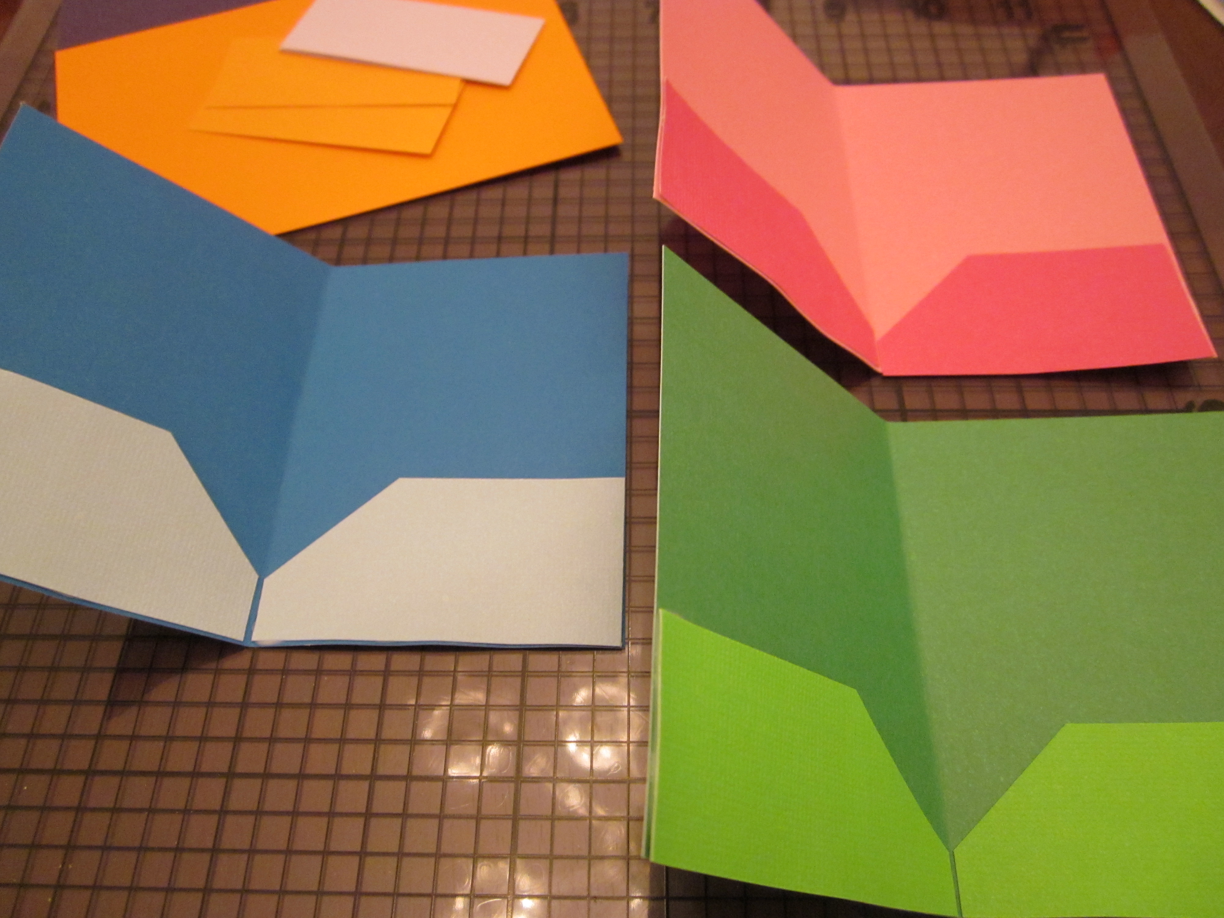 Creating the Folder. Fold the paper in half lengthwise. If using two letter-size sheets, cut a length of paper about 1 inch wide and 11 inches long. Glue the strip along the join between the two sheets. Once the glue is dry, fold the paper in half along the join. Cut two pieces of paper 5 .