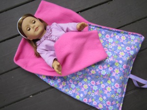 AG doll in sleeping bag