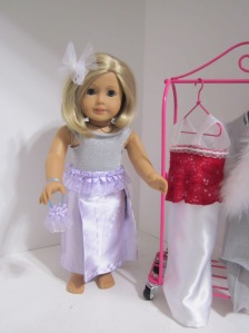 American Girl purple skirt and silver top