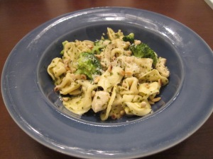 tortellini with chicken and pesto in bowl