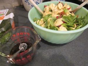 tortellini pasta salad mixing